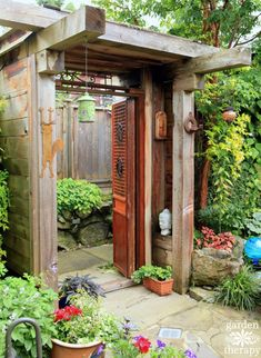 Entry to create a secret garden space made with antique wood doors and plenty of garden art. Come tour some quirky and diverse Secret Gardens like this one.