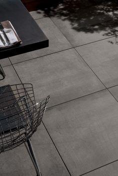 Porcelain pavers from Archatrak create amazing looking courtyards, patios, roof decks and outdoor landscapes Concrete Look Tile, Concrete Deck, Outdoor Tiles, Outdoor Flooring, Euro, Flooring Options, Decorative Tile, Outdoor Landscaping, Porcelain Tile