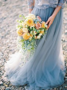 This calming Baltic Sea wedding inspiration with a heavenly blue wedding dress will leave you feeling sated with delight. Blue Yellow Weddings, Yellow Wedding Flowers, Dusty Blue Weddings, Cream Flowers, Dusty Blue Bridesmaid Dresses, Blue Wedding Dresses, Wedding Bouquets, Wedding Blue, Wedding Beach