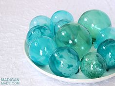 DIYJapanese Faux Glass Fishing Floats ~ made from large clear holiday glass ornaments, Mod Podge sheer color aqua, glass stain in a green or blue color, translucent or frost glass paint in a green or blue, craft knife.  (Suggested paints and pictorial tutorial on the site.)