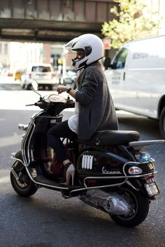 Her shoes! Wow. What an amazing commuter. Vespa in the city.