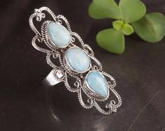 "Product description Beautiful ""Larimar"" made with love using 100% pure sterling silver and Larimar gemstones. The perfect to wear casually and will go with all kinds of dress and occasion. This..."