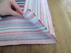 A method for sewing neat and tidy box cushion corners.