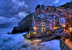 """Riomaggiore - Perfect beach island in Italy ... Part of """"Cinque Terra"""", for those of you who can't figure that one out it means """"five islands"""" .... Came here the Summer of 2008 with Christen Brown and Dez Sedio ... wonderful street fair where I won a cheap bottle of wine and a coloring book"""