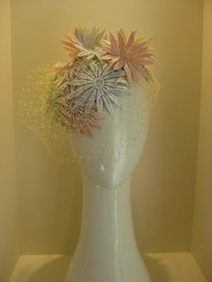 Jill & Jack Millinery - Pastel Daisy crown with lemon veiling $375. Perfect pastel purity for Oaks day!