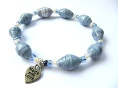 Denim Blue Upcycled Scrapbook Paper Bead Bracelet. $16.00, via Etsy.