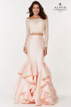 Two piece mermaid gown with a ruffled skirt, laced long sleeve crop top and small keyhole back.