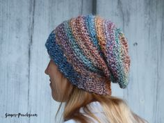 A free crochet pattern for the Stockholm Slouch Beanie using a Lion Brands Homespun yarn. It's easy and simple, perfect for quick projects, and beginners!