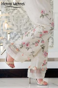 Ivory raw silk boot cut trousers with pink diamante embroidery and embellishment with tassel accessories. Please note these are trousers only. Please note deli Pakistani Dress Design, Pakistani Outfits, Indian Outfits, Salwar Designs, Fashion Pants, Look Fashion, Fashion Dresses, Salwar Pants, Sleeves Designs For Dresses