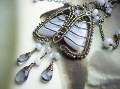 lung jewelry!  Breathe...  sterling silver and blue crazy lace agate necklace. $189.00, via Etsy.