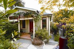 Alma's Earthquake Cottage is flanked on three sides by her garden, an integral part of the overall style.
