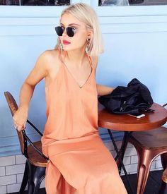 We're getting nothing but summer vibes from @laurajadestone - she wears The Prelude Dress in burnt peach - shop now - link in profile #finderskeepersthelabel #regram