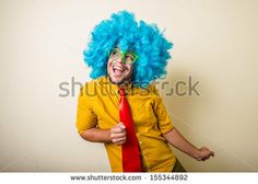 crazy funny young man with blue wig on white background by Eugenio Marongiu, via ShutterStock BUY IT FROM $1