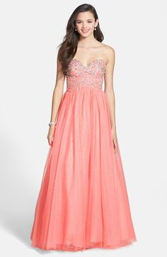 Free shipping and returns on Way-In Crystal Embellished Glitter Ballgown (Juniors) at Nordstrom.com. A beautiful strapless gown with a full, swirling skirt infused with starry glitter is detailed with placed crystals at the sweetheart bodice, creating a look fit for a princess.