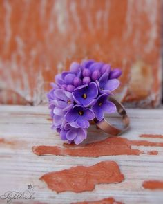 Ring with flowers of lilac is a pretty gift for birthday, Valentine's Day ...  The flowers are made of air dry clay.    Size flower: diameter of 1,5 inches  Adjustable metal ring base.    Made to order. Item can not be 100% identical.