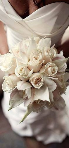 White bridal bouquet www.tablescapesbydesign.com https://www.facebook.com/pages/Tablescapes-By-Design/129811416695