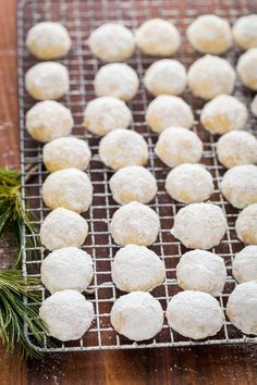 Darling almond snowball cookies that melt in your mouth! Almond Snowball Cookies are perfect for Christmas cookie platters and gifting (make-ahead recipe!)   natashaskitchen.com