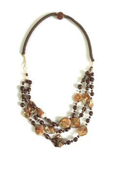 """Handmade necklace consist of three strands of freshwater pearls and mother of pearl tied together on a silk cord. Button closure. Lovely handwork made in Bali. Available in white bronze or black.  Necklace measures 21""""  Ocean Finds Necklace by Ottoman Imports. Accessories - Jewelry - Necklaces Kentucky"""