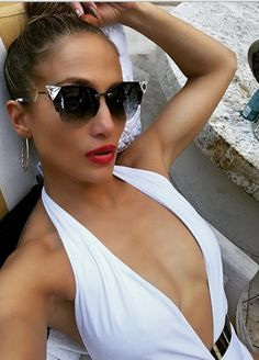 Who made Jennifer Lopez's black cat sunglasses and white swimwear?