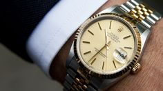 Spotted Street Style: Roberto Serrallés, master distiller and vice-president for Caliche Rum brand. Detail shot of Roberto's classic Rolex watch, a gift from his father when he completed his Ph.D. in environmental sciences. It is identical to the one his father wears every day so that there are two of the same watches to pass down through the family instead of one. Photography by ©Sophie Elgort