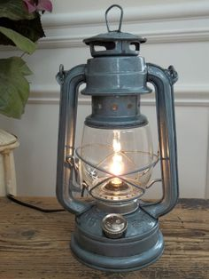 Slightly aged look to this cute little electric lantern lamp. Lantern Lighting, Lantern Lamp, Lanterns, Electric Lantern, Single Tree, Wagon Wheel Chandelier, Oil Lamps, Ceiling Fixtures, Lamp Light