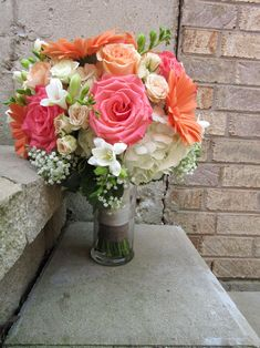 Coral, peach and white wedding bouquet including roses, freesia, gerbera daisies and baby's breath. Designed by Brittany Gerbera Daisy Bouquet, Bridal Bouquet Coral, Coral Wedding Flowers, Prom Flowers, White Wedding Bouquets, Bride Bouquets, Wedding Colors, Gerbera Daisies, Wedding Dresses