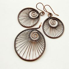 Beautiful wire wrapping; one of six in a series of nautilus inspired designs.
