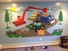 This little boys room is no longer Under Construction, but now he has a bright and color wall mural of construction equipment to entice him for future big boy toys!