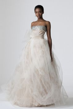 Strapless nude tulle ballgown with crystal beadwork at bust, blush hand-painted floral tulle draped skirt and horsehair bow at waist