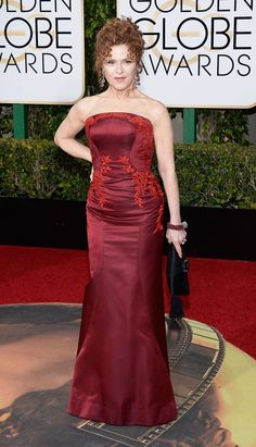 Bernadette Peters The Mozart in the Jungle actress steamed up the carpet in a burgundy, strapless dress with floral embroidery.