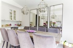 Chic, glam dining room boasts two Suzanne Kasler Morris Lanterns illuminating a salvaged wood dining table lined with purple velvet dining chairs placed before a wall lined with three leaning black framed mirrors. Decor, Velvet Dining Chairs, Dining Room Design, Mirror Design Wall, Mirror Wall Living Room, Mirror Wall Bathroom, Mirror Wall Bedroom, Dining Room Mirror Wall, Mirror Dining Room