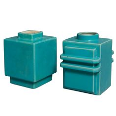 France circa 1930 Set of two modernist blue glazed ceramic vases, each based on a cube form, one with stepped base and opening (6 in x 6 in, height 7 in.), and the other with geometric flange flourishes (height 7 in, 5 in x 6 in.), by Robert Lallemant, French circa 1930.