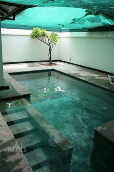 Turquoise blue indoor swimming pool