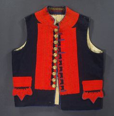 The People's History of Costume: Traditional Folk Attire    Antique Moravian man's vest from Nivnice in the Czech Republic. The vest is made from heavy navy blue felted wool and embellished with stunning red, blue and green embroidery on the front and back.