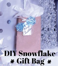 Craft a vintage snowflake gift bad to put all your homemade goodies in! The smallest touches make all of your holiday gifts even more heartfelt!