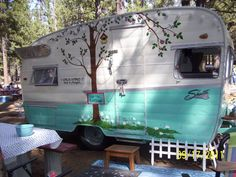 This one is too cute.  Obviously loved.  This web site has a bunch of vintage trailers.  www.littlevintagetrailer.com.  I had so much fun poking around.
