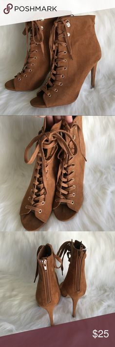 "Forever21 brown high heel booties Forever21 high heel brown lace up booties.  Open toe, lace up.  Faux suede, man made materials. Heel measurement 4.5"". New with tags. Best offer. Forever 21 Shoes Heels"