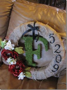 Great housewarming gift - burlap wreath with moss-covered letter and address numbers.