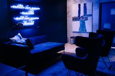 The blue room was meant to resemble a bachelor pad and featured contemporary artwork, a ping-pong table, and neon signage of the candy brand's tagline that served as a photo op for guests.