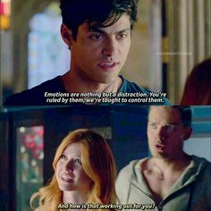 Alec and Clary showdown begins and look at Jace's face! He's looks like he's thinking 'Clary you are soooo screwed...'