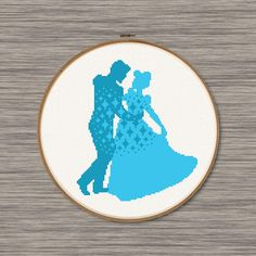 "PDF cross stitch pattern of a blue silhouette of Cinderella and Prince dancing! Pattern includes: Colored Grid (Page 1 of PDF) Symbol Grid (Page 2 of PDF) DMC Color Chart (Both pages of PDF) Size: Approximately 6"" x 7"" (14 count Aida) 83 stitches wide, 97 stitches tall 2 colors For"