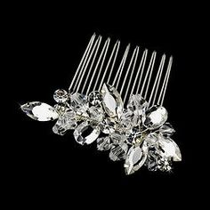 "TC-8882 Simple and timeless. This dazzling embellishment can be added to any bridal updo. Composed of marquise, round and oval cut stones and embellished with Swarvoski crystals, this comb offers that sparkling touch you've been looking for!   Size: 2 1/2"" x 1"""