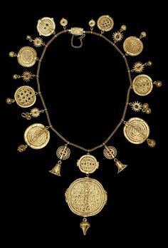 Africa | A necklace consisting of thirty-six hollow lost wax cast gold beads threaded in a symmetrical arrangement onto a European-made gold chain. | Asante people, Ghana. Probably from the Royal Palace, Kumase | 19th century || {5.4}