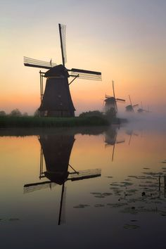 Sunrise, Molenkade, Kinderdijk, Netherlands  Kinderdijk is situated in a polder at the confluence of the Lek and Noord rivers. To drain the polder, a system of 19 windmills was built around 1740. This group of mills is the largest concentration of old windmills in the Netherlands.  http://en.wikipedia.org/wiki/Kinderdijk