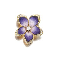 A purple and white enamel flower brooch with diamonds, circa 1900