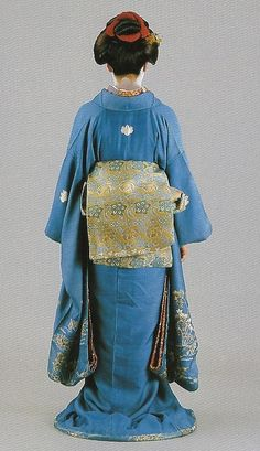 Scan B3.  Scans from book: 300 years of Japanese women's appearance, kimono, kanzashi etc. ISBN4-87940-541-8.  The embroidered furisode and brocade'technique obi appear to date from the second half of the 19th century.  Image scanned by Lumikettu of Flickr