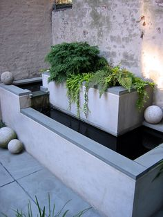 replace the fountain with planters. building a concrete form would be a pretty easy weekend project.