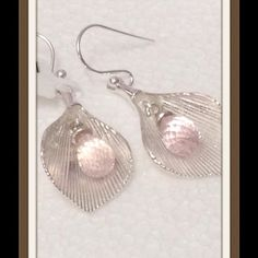 2016 Color of Year Rose Quartz Tulip Earrings NEW Genuine Galilea Rose Quartz Tulip Style Earrings in .925 Sterling Silver Nickel Free TGW 4.00 Cts. Rose Quartz is 1 of 2 2016 Colors of the Year. One of the most desired varieties of quartz, Galilea rose quartz stone, mined in Brazil, is a universal symbol of love and romance. Prized for its soft pink hues, this gem has captured the hearts of gem lovers around the world Jewelry