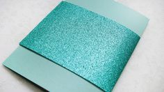 Matte blue card with shimmery turquoise band