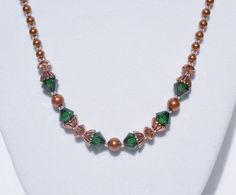 Swarovski copper pearl and green crystal necklace by ParkhillDesigns on Etsy